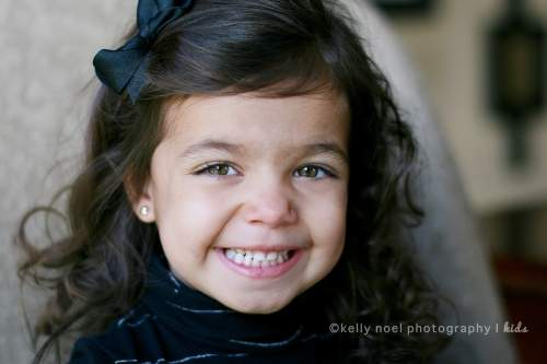 Young girl with bow smiling
