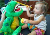 Infant First Visit, with a dinosaur