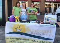 Suncoast Pediatric Dentistry table with the Tooth Fairy